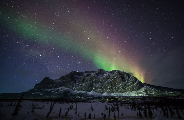 Multi coloured Aurora Borealis lights over Sukakpak Mountain in northern Alaska.
