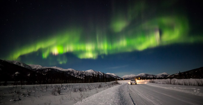 Stunning view of the northern lights over an icy road