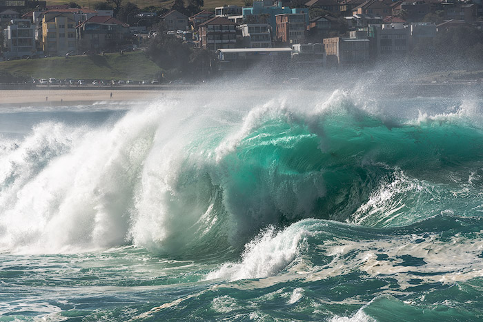 Dramatic wave photography taken with a telephoto lens.