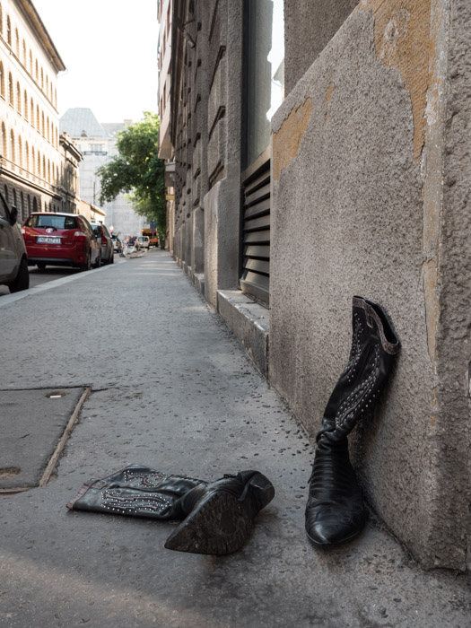 Street photography of a pair of boots left on the street, taken with a Panasonic gh5 by Craig Hull