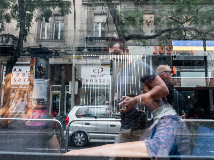 Street photography scene with the photographer reflected in a shop window, taken with a Panasonic gh5 by Craig Hull