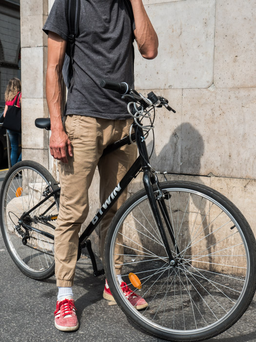 Street photography of a man on a bike, taken with a Panasonic gh5 by Craig Hull