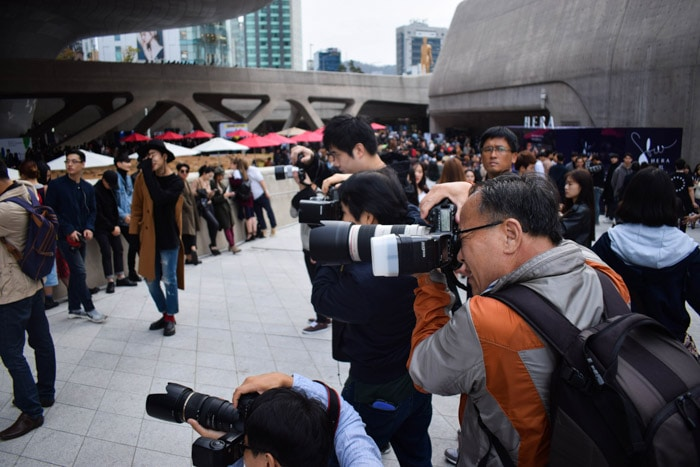 Street photography of a group of media photographers.