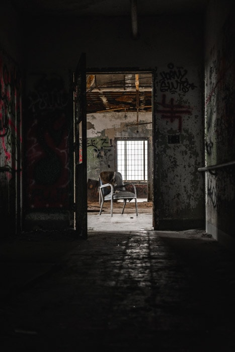 Atmospheric and dark photo of the interior of an abandoned building as part of a photo-essay