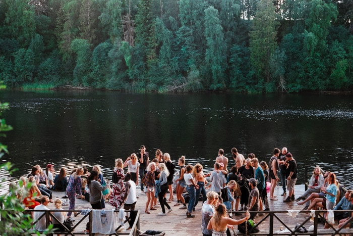 Documentary photography essay of a group of people at an event by a lake.