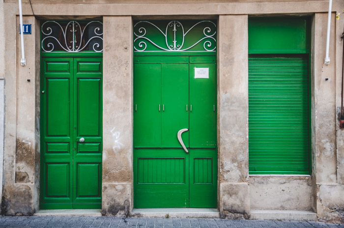 Photo of the facade of a building with emerald green doors and shutters - the theme for this photo walk was rectangles.