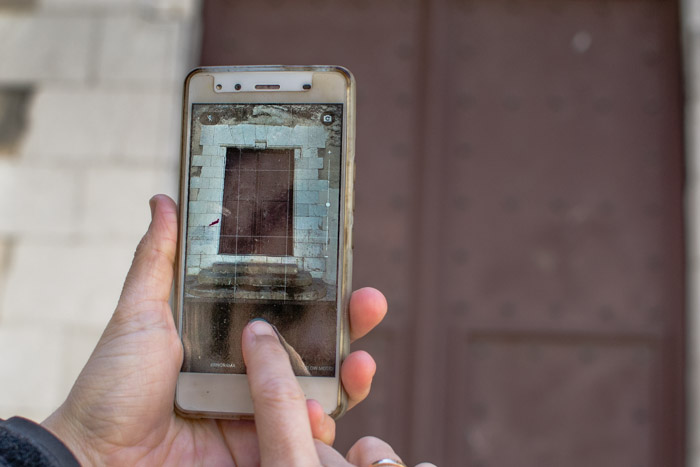 Using a smart phone to photograph a window frame on a photography walk