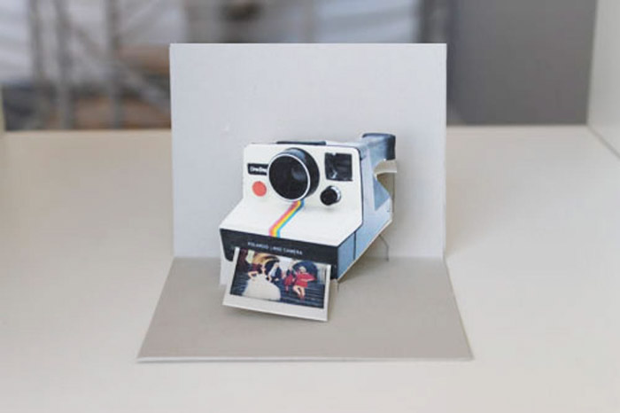A personalised polaroid pop up card - photo gifts - http://www.brit.co/pop-goes-the-diy-pop-up-name-card/