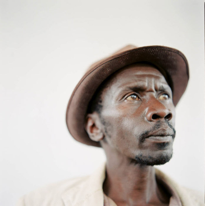 Kristi Carlson portrait of a man in brown hat. Famous Portrait Photographers