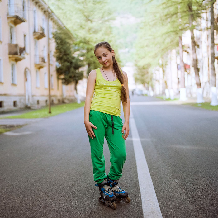 Maria Gruzdeva portrait of a young girl standing in the middle of the road. Famous Portrait Photographers