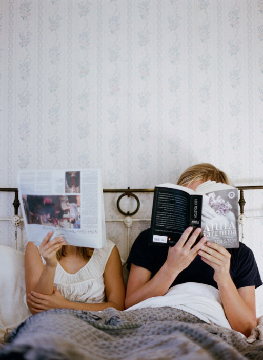 Nirav Patel photo of a couple reading in bed. Famous Portrait Photographers