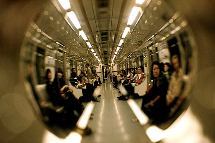 Crystal ball photography of a busy train interior. Street photography accessories.