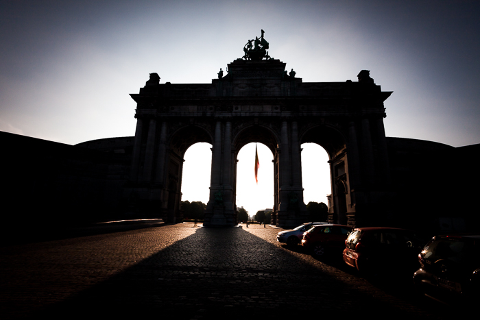 Dramatic shadowy front view photograph of the Arc du Cinquantenaire in Brussels. urban photography