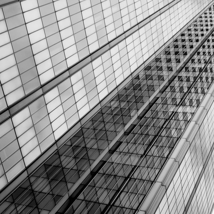 The multiple reflections playing together create a checked pattern on this building's facade.