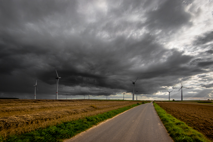 Dramatic stormy sky over a countryside landscape. What is HDR photography?
