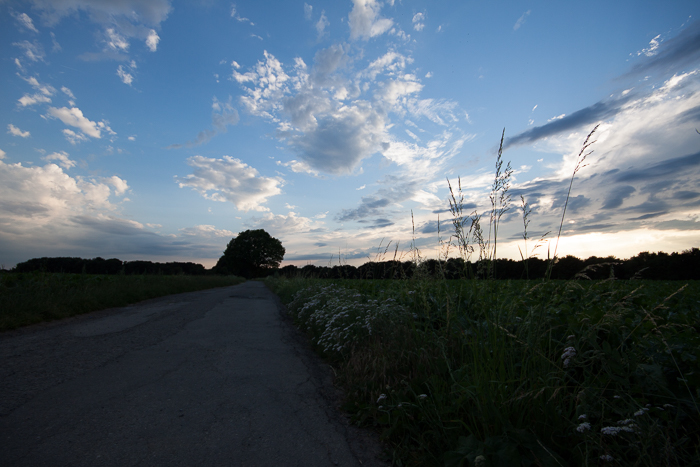 Landscape photography of a countryside road at sunset: the sky is bright and the land below is dark. Camera: Canon 50D. What is HDR photography?