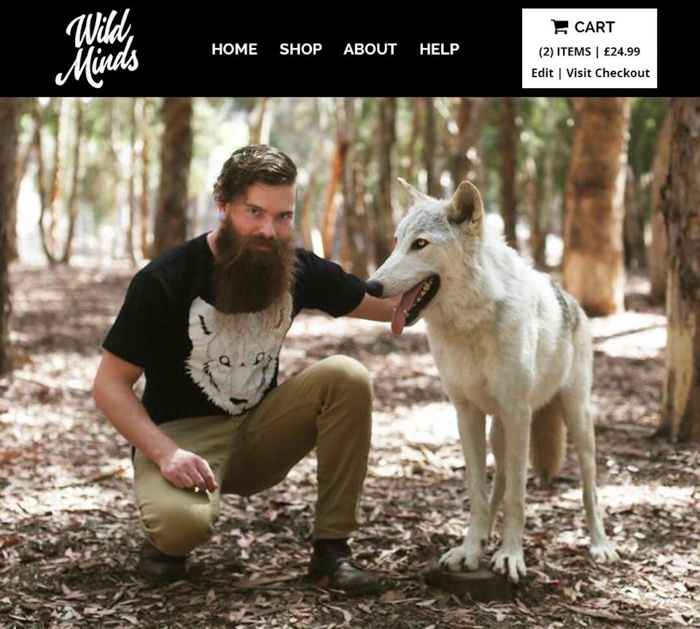 A WildMinds Catalogue advertising showing a man with a white dog posed in a forest - commercial photography tips