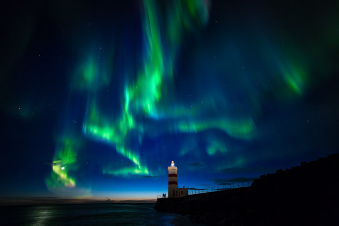 Full-Frame Astrophotography shot of a lighthouse with northern lights above. Taken with rokinon 14mm lens at 1.3 Sec - F/2.8 - ISO 1600
