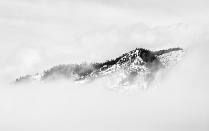 Atmospheric misty and snowy mountainous landscape - tone and weight balance in photography