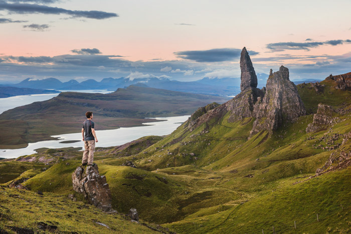 A man standing on a rock with a magnificent landscape behind - compositional photography rules