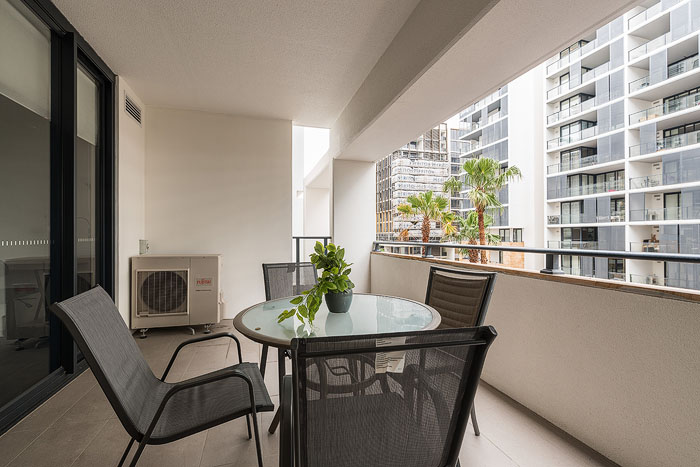 Bright and airy real estate photography shot of the balcony of an apartment