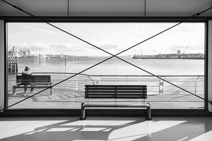 A black and white street photography shot of Devonport, Auckland, in the bright sun.