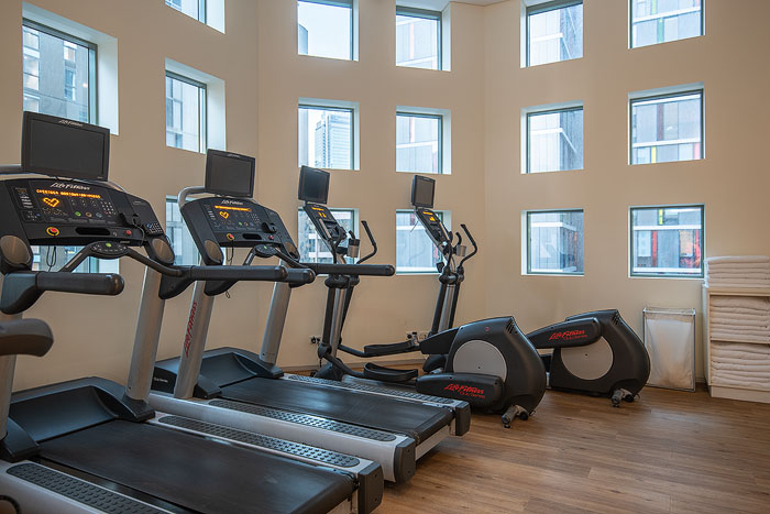 Exercise machines in the interior of a gym shot for commercial real estate photography