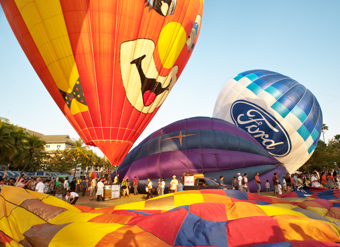 Crowds of people enjoying an afternoon at a hot air balloon festival in Chiang Mai, Thailand. Editorial photography.