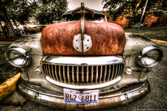 A porttrait of a rusty car hubcap - freelance photography shot