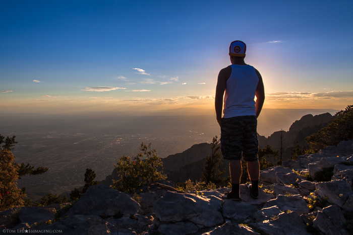 A portrairt of a man standing on the edge of a cliff at sunset - tips for starting in Freelance photography