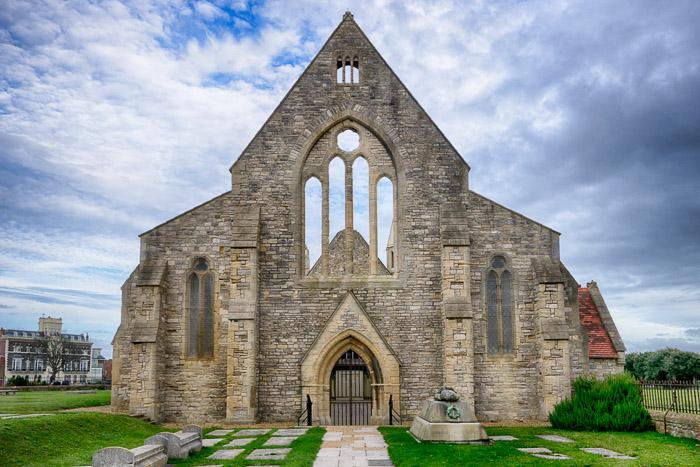 An old church against a cloudy blue sky - travel photography jobs