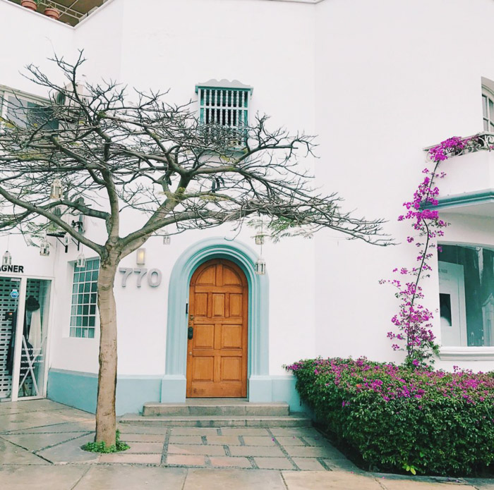 Bright and airy architecture photography of a white walled house. Instagram tips for social media photography.