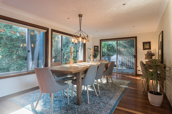 A real estate photography shot of the interior of a dining room