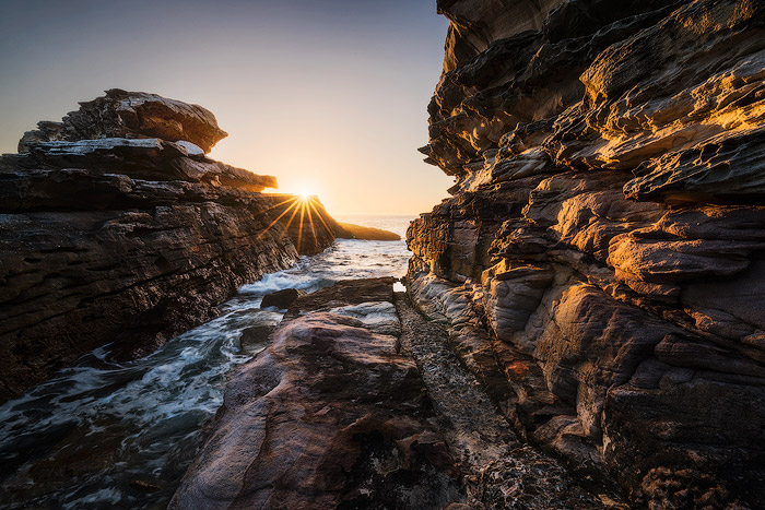 A rocky seascape at sunset
