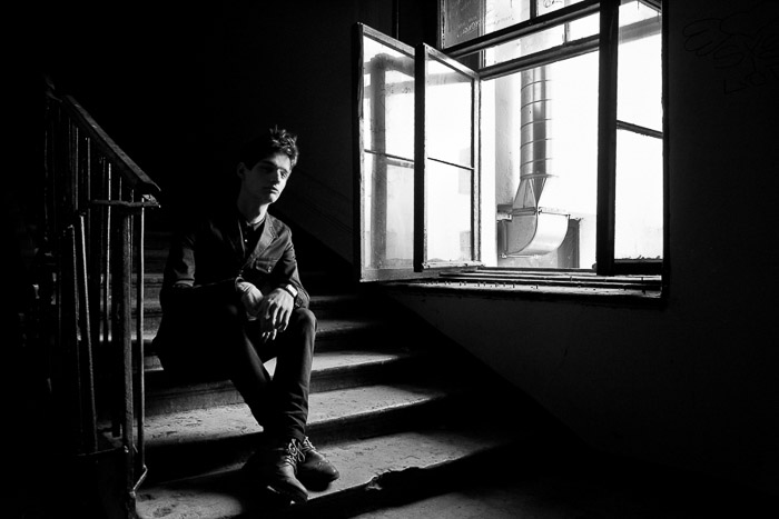 A natural light photography portrait of Sergey Sarkissian on the stairs in Saint Petersburg