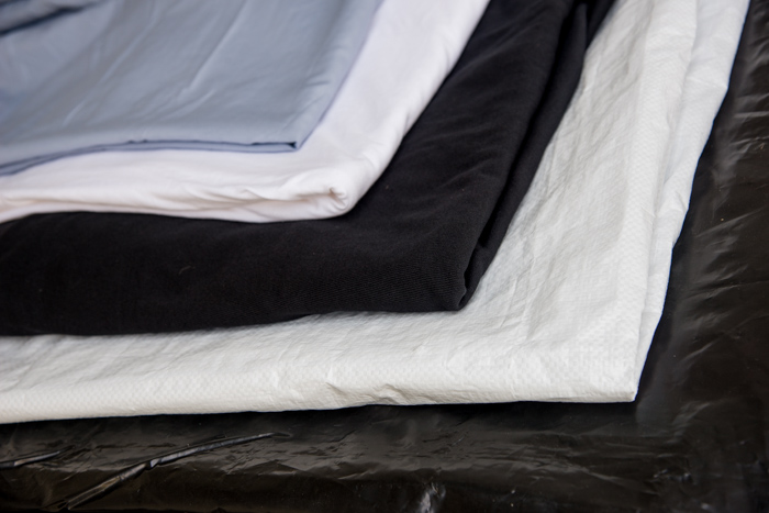 Photo of the material needed to set up a natural light outdoor portrait photography studio.