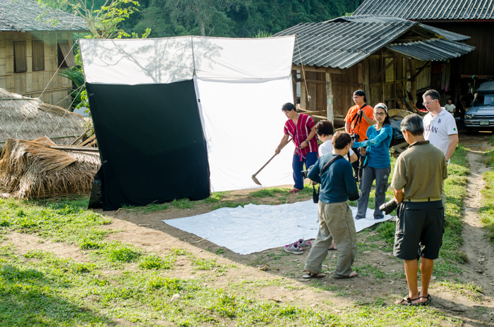 Setting up the outdoor portrait photography studio for a workshop in a remote village in northern Thailand.