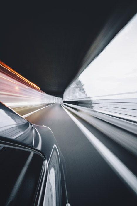 A blurry motion photography shot taken from a moving vehicle - panning shot