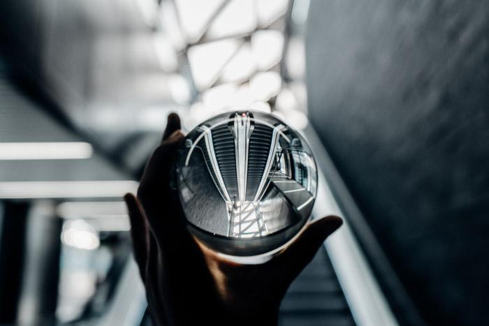 A hand hold a crystal ball photography