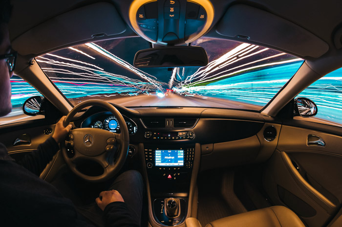 Cool photo from inside a car at night with light trails streaming by