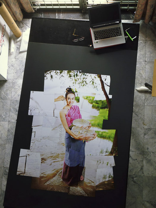 A photomontage on a large table as it is being created