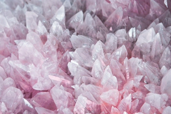 A macro photography shot of pink crystals