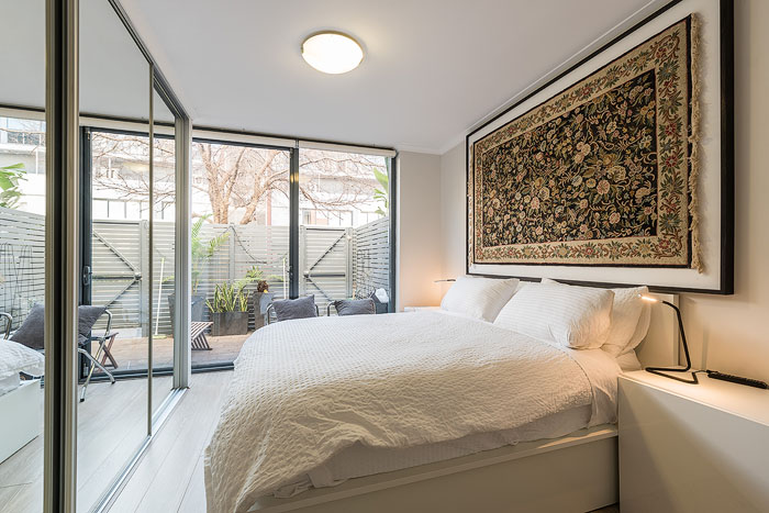 Bright and airy real estate photography shot of the interior of a bedroom