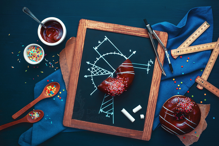 Overhead still life photography ideas of fun food photography on dark background with chalk drawings