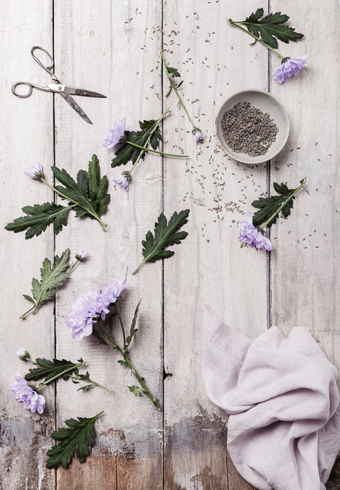 Still life photography of lavender and flowers on wooden boards, overhead shot.