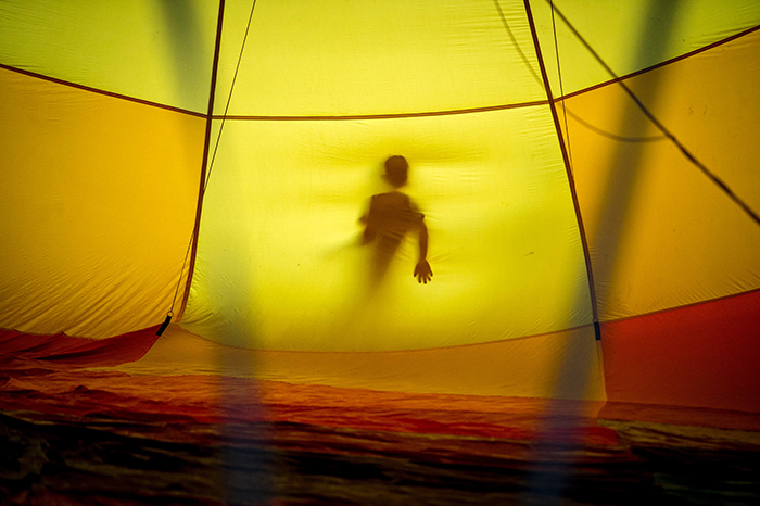 Earl Richardson surreal photography of a persons silhouette seen through a yellow tent