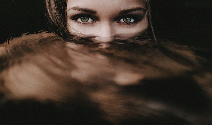 Mickael Cresset close up portrait of a girl with the bottom half of her face underwater - surreal photography