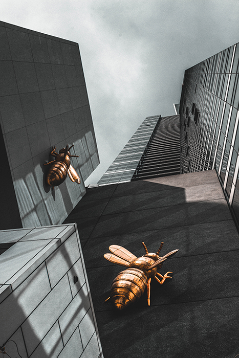 Oliwier Gesla photo of metal wasps scaling a skyscraper - surreal photography