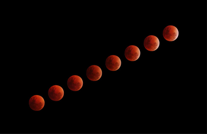 time lapse photography of red planets on black background taken with a time-lapse camera