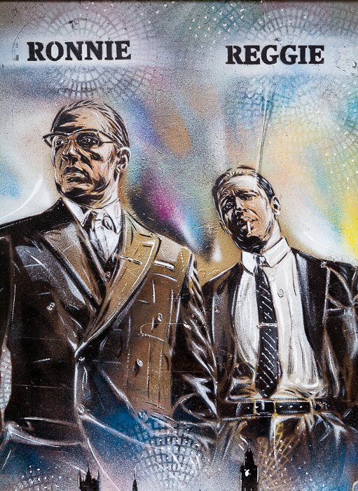 A graffiti mural of Ronnie and Reggie Kray. Travel photography shot list.